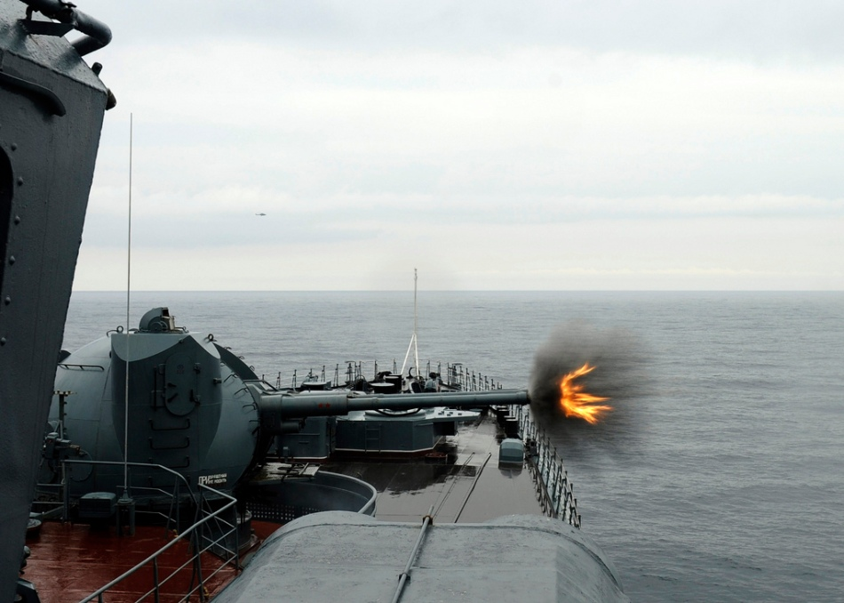 Russian navy destroyer firing at a distant target during a gunnery exercise, June 29, 2011