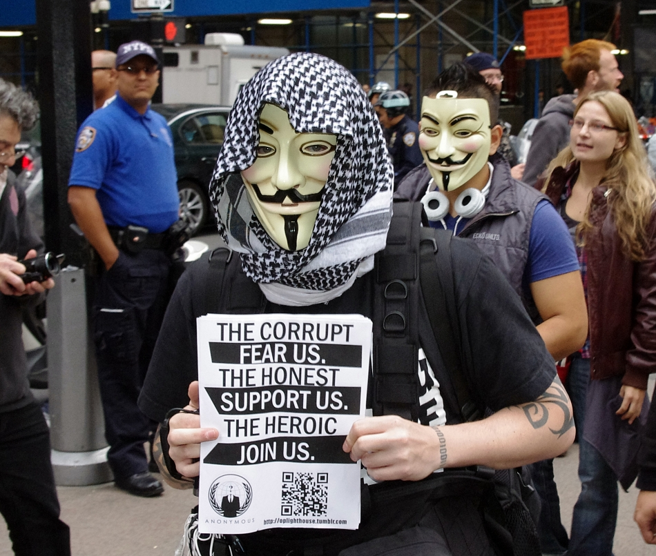 A member of Anonymous handing out fliers