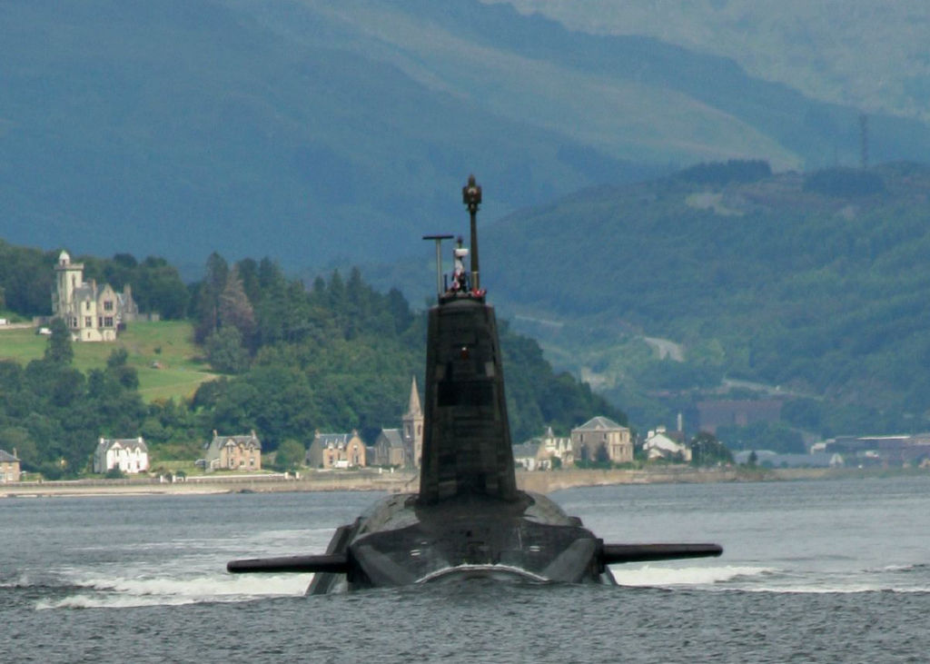 A Trident missile armed Vanguard class ballistic missile submarine leaving its base in the Firth of Clyde.