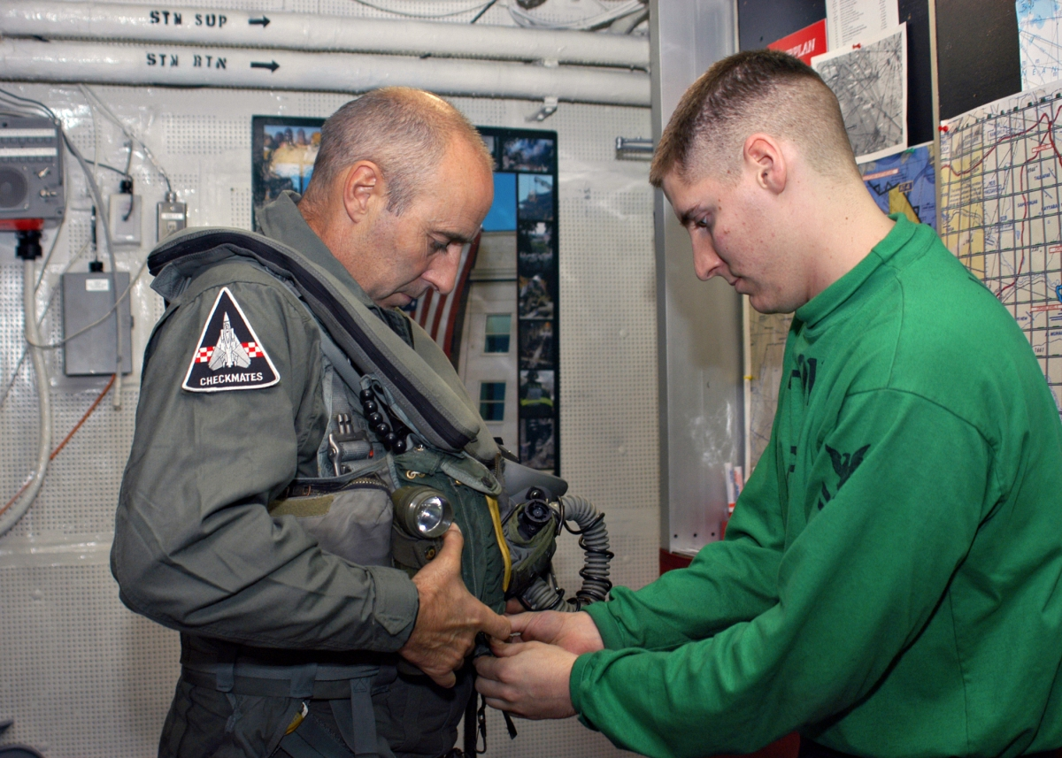 US_Navy_031127-N-4669B-001_British_Major_General_Graeme_Lamb_is_fitted_for_his_flight_suit_by_Aircrew_Survival_Equipmentman_2nd_Class_Jeffery_D._Schmidt