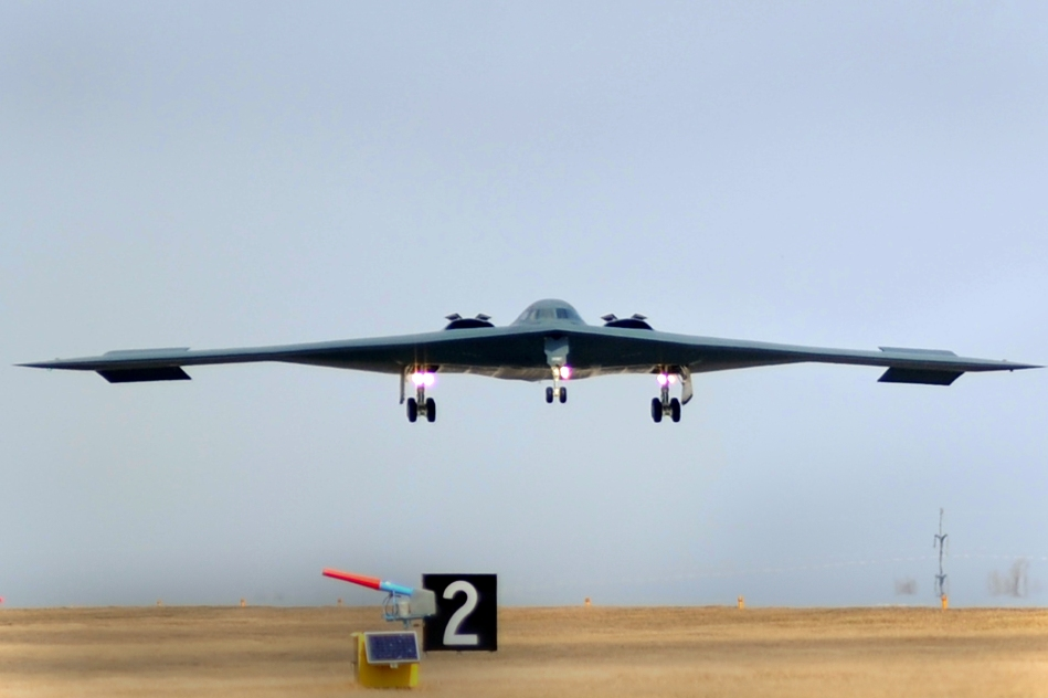 An American B-2 Spirit bomber lands at Whiteman Air Force Base after a bombing mission over Libya.