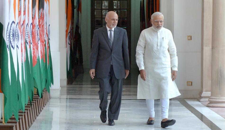 Modi walking with Afghan President Dr. Ashraf Ghani, April 29, 2015.