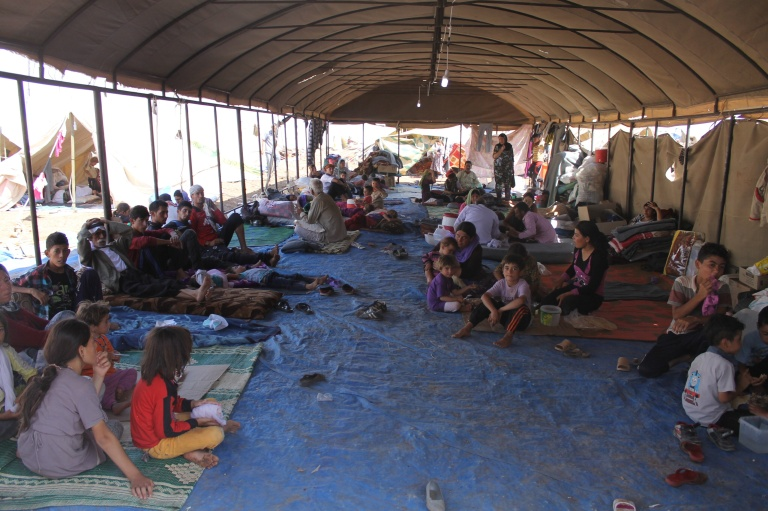 Stranded on Mount Sinjar by ISIL, Yazidi refugees receive aid from the International Rescue Committee, August 2014 (DFID).