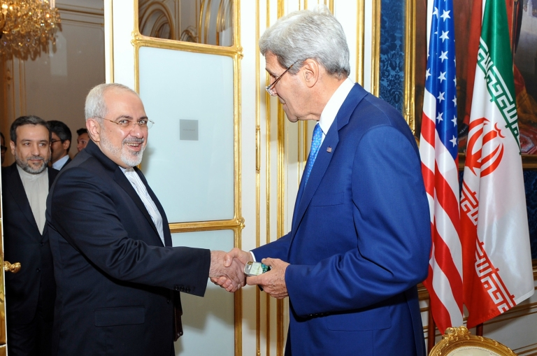 US Secretary of State John Kerry shakes hands with Iran Foreign Minister Javad Zarif, July 14.