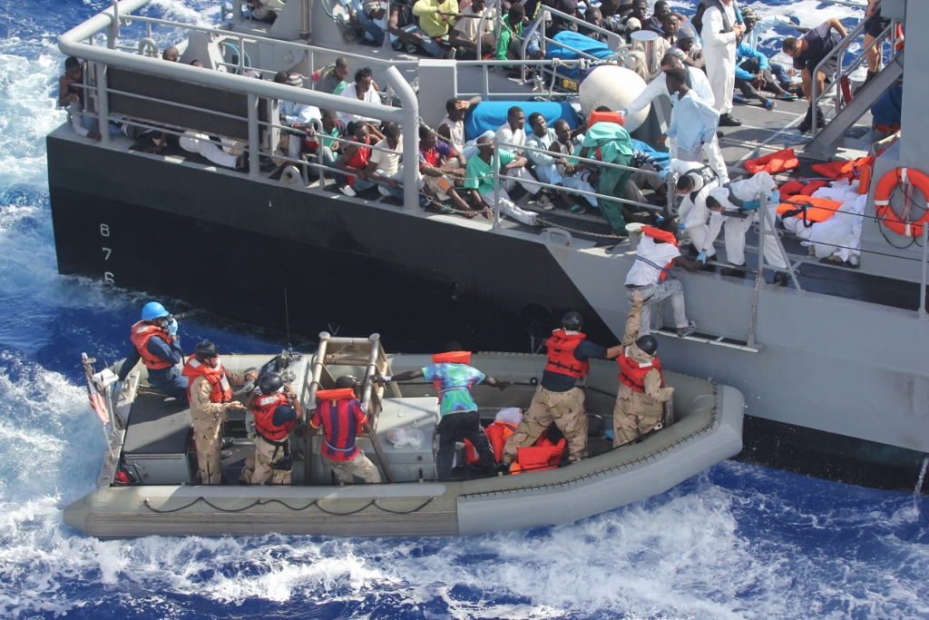 MEDITERRANEAN SEA (Oct. 17, 2013) Distressed persons are transferred from the amphibious transport dock ship USS San Antonio (LPD 17) to Armed Forces of Malta offshore patrol vessel P52. San Antonio provided food, water, medical attention, and temporary shelter to the rescued. San Antonio rescued 128 men adrift in an inflatable raft after responding to a call by the Maltese Government. (U.S. Navy photo/Released) 131017-N-ZZ999-009 Join the conversation http://www.navy.mil/viewGallery.asp http://www.facebook.com/USNavy http://www.twitter.com/USNavy http://navylive.dodlive.mil http://pinterest.com https://plus.google.com